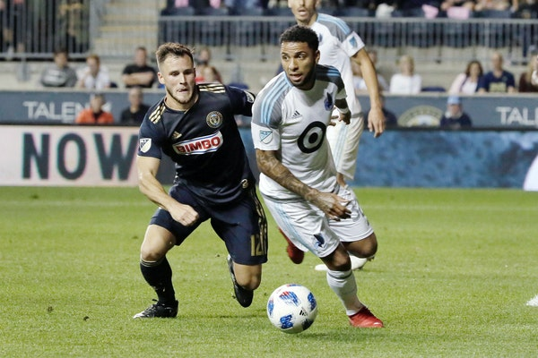 Philadelphia's Keegan Rosenberry and the Loons' Alexi Gomez chase the ball in the 2nd half Saturday night.