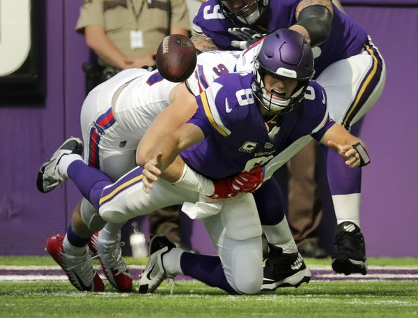Kirk Cousins was sacked in the first quarter, a sign of bad things to come for the Vikings on Sunday at U.S. Bank Stadium.