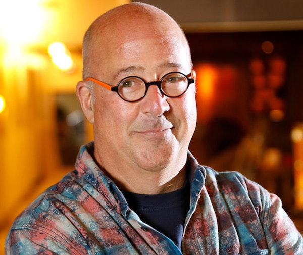 Chef Andrew Zimmern poses for a portrait inside his new restaurant Lucky Cricket.