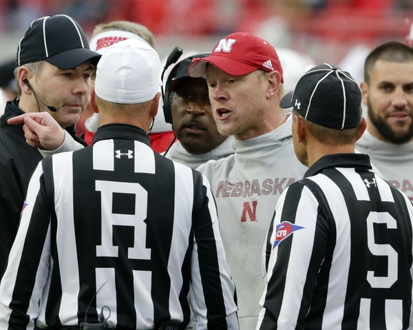 Nebraska coach Scott Frost, center, exchanged words with referee Ron Snodgrass and side judge Dominique Pender during a 42-28 loss to Purdue last Satu