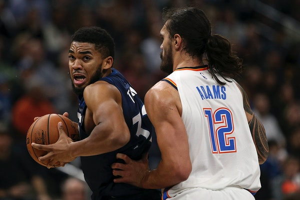 Minnesota Timberwolves center Karl-Anthony Towns (32) drove to the basket around Oklahoma City Thunder center Steven Adams (12) in the first half.