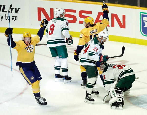 Predators right winger Craig Smith (15) and Ryan Johansen, left, celebrated after Smith scored a goal against Wild goaltender Alex Stalock in the firs