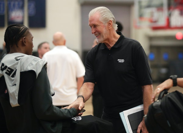 Miami Heat president Pat Riley shakes hands with forward Josh Richardson during training camp.