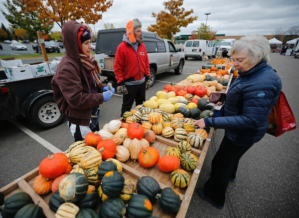 Anna and John Mau with Mau Family Produce brought gourds and pumpkins to the Maple Grove Farmers Market on Thursday, catching the eye of Yvonne Palka