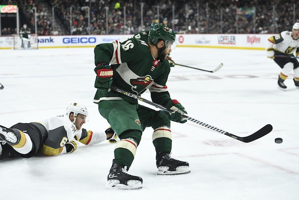 Minnesota Wild left wing Jason Zucker (16) controlled the puck as Vegas Golden Knights defenseman Colin Miller (6) fell to the ice in the first period