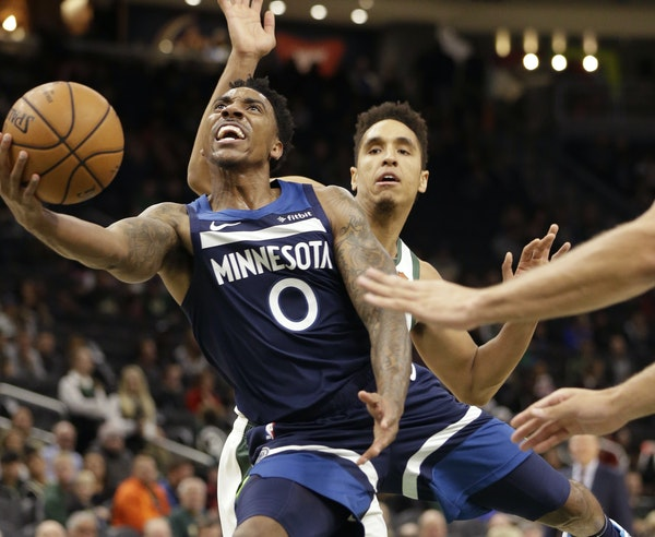 Wolves guard Jeff Teague worked his way around Bucks guard Malcolm Brogdon during the first half Friday night in Milwaukee.