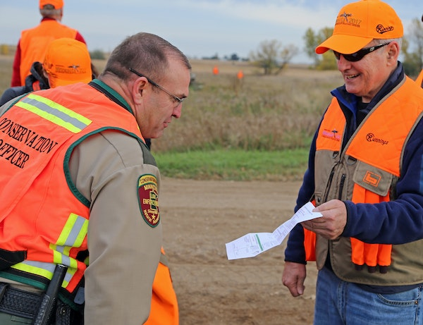 DNR conservation officer Lt. Gary Nordseth checked Gov. Dayton's license before the governor went afield on the first day of the 2017 ringneck seaso