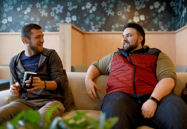 """Recruiter Dalton Scott, left, and """"fly-in"""" visitor Corwin Harris chatted at a WeWork office."""