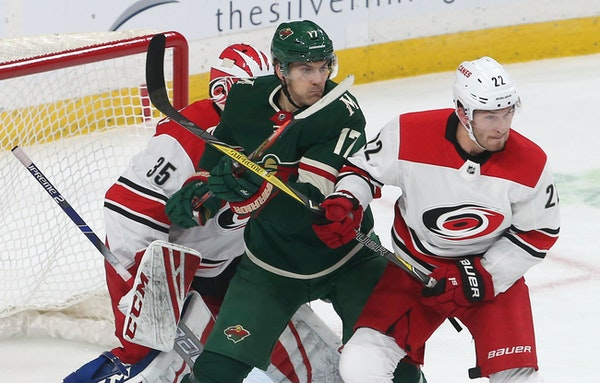 The Wild's Marcus Foligno was bottled up between the Hurricanes' Curtis McElhinney, left, and Brett Pesce during the first period Saturday.