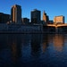 The setting sun illuminated the Mississippi River and the St. Paul skyline, with City Hall on the left, as seen from Harriet Island Park in October.
