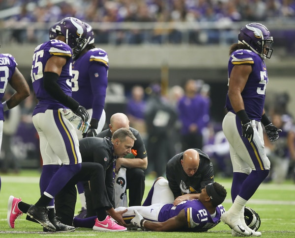 Viking cornerback Mike Hughes was attended to Sunday after injuring his knee against the Cardinals.