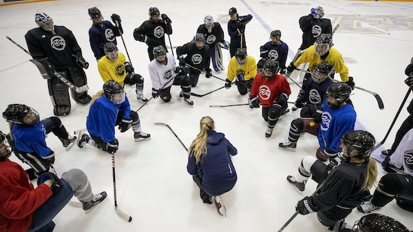 A huddle before the history: Minnesota Whitecaps co-head coach Ronda Engelhardt spoke to her players during practice this week.