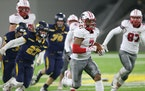 Lakeville North running back Raja Nelson (7) headed for the end zone against Prior Lake during a long first-quarter TD run Friday at TCO Stadium in Ea