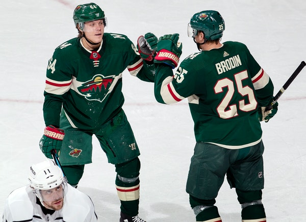 Mikael Granlund and Jonas Brodin celebrated an empty net Granlund goal in the third period.