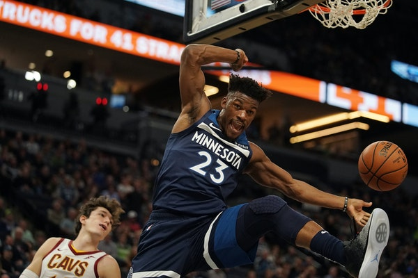 The Timberwolves' Jimmy Butler dunks in the first half against the Cleveland Cavaliers on Friday