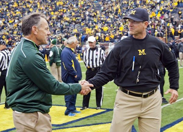 Michigan State coach Mark Dantonio, left, has had the upper hand against Jim Harbaugh and Michigan.