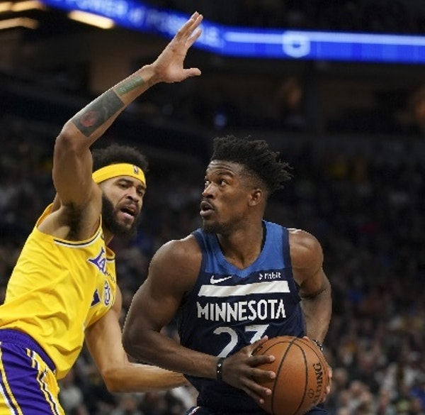Timberwolves guard Jimmy Butler looked for a shot in the first quarter while guarded by Lakers center JaVale McGee (7). Butler went on to score 32 poi