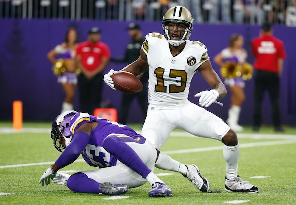 New Orleans wide receiver Michael Thomas (13) celebrated after catching a pass in front of Vikings strong safety George Iloka, who eventually got benc
