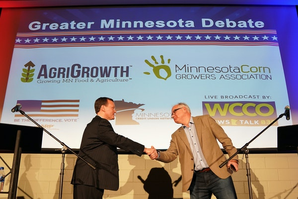 Minnesota gubernatorial candidate Hennepin County Commissioner Jeff Johnson, Republican, left, shakes hands with Congressman Tim Walz, DFL, after they