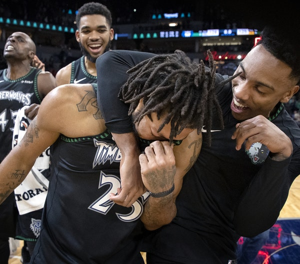 Jeff Teague gave Derrick Rose a hug after Rose scored a career-high 50 points in leading the Timberwolves over the Jazz 128-125 at Target Center on We
