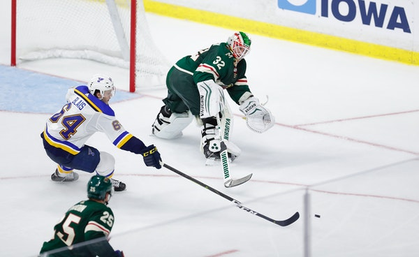 Alex Stalock, seen here playing the puck in a preseason game, picked up an assist in the Wild's 5-4 overtime victory Saturday against the Lightning.
