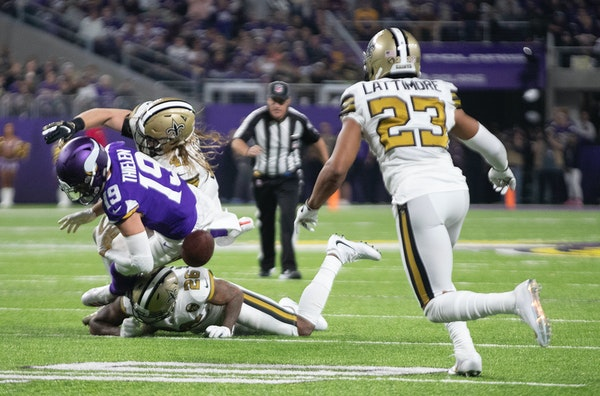 Saints cornerback Marshon Lattimore (23) closed in to recover a fumble by Vikings wide receiver Adam Thielen (19) late in the second quarter, one of t