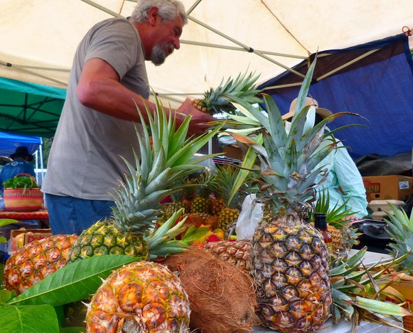 Fresh fruit makes Hanalei's Saturday Farmers Market a visit worth savoring. Besides pineapples and coconuts, a local specialty is longan, a cousin o