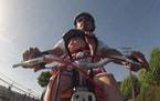 A still from a YouTube video about the use of a Yepp Mini, a Thule contraption for getting children anchored in front.