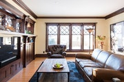 Architect Dan Nepp took design cues from exisiting spaces in his 1911 Craftsman-style home, above, such as the diamond-pane windows, for his seamless