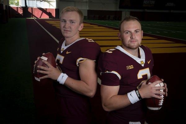 Gophers quarterbacks Zack Annexstad, left, and Tanner Morgan.