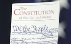 FILE - In this March 23, 2016 photo, the Constitution is held by a member of Congress on Capitol Hill in Washington. President Donald Trump says he wa