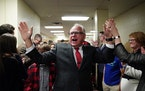DFL gubernatorial candidate Tim Walz was congratulated by supporters as he was led through the kitchen to give a victory speech after his win.