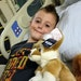 Quinton Hill, 7, lost movement in one arm due to a mysterious syndrome known as acute flaccid myelitis. Treatment at Children's Hospital followed mult