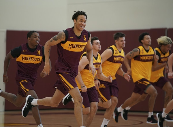 Junior guard Amir Coffey (5), shown running sprints with his Gophers teammates, is at full strength after missing most of Big Ten play last winter.
