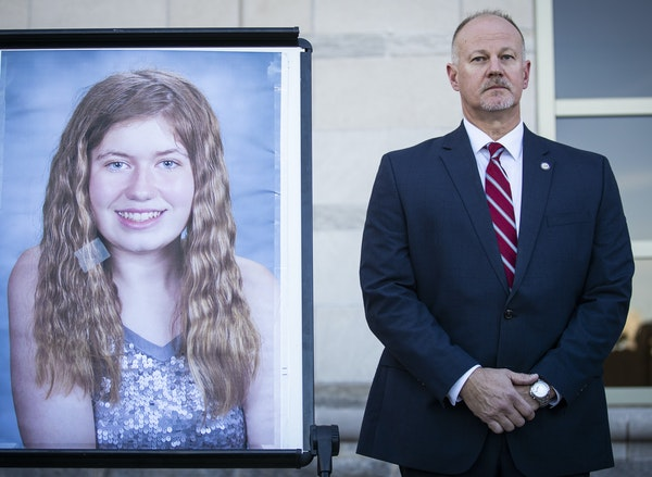 Special agent in charge Chris Deremer with the Wisconsin DCI stands next to a photo of Jayme Closs during a news conference in October.