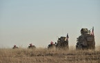 In this photo taken Thursday, Nov. 1, 2018, Turkish and U.S. troops conduct joint patrols around the Syrian town of Manbij, as part of an agreement th