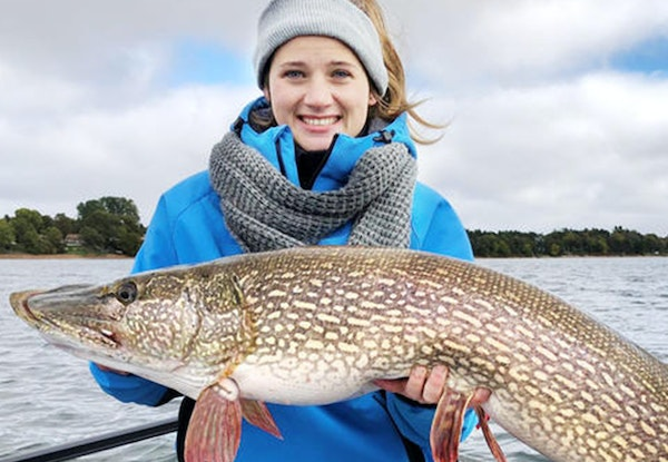 Maddy Ogg of Sartell, Minn, showed off the state catch-and-release record northern pike, which measured 43½ inches, that she caught on Lake Mille Lac
