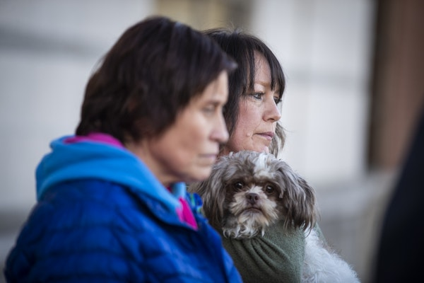 Jennifer Smith, left, and Suzi Allard, aunts of Jayme Closs, stand behind the podium during the press conference. Allard holds Jayme's dog Molly.