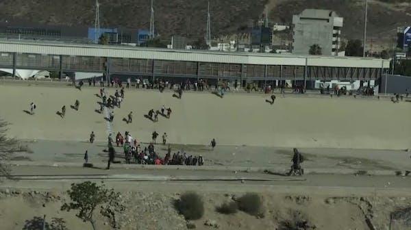 Migrants try fence breach, U.S. agents fire tear gas
