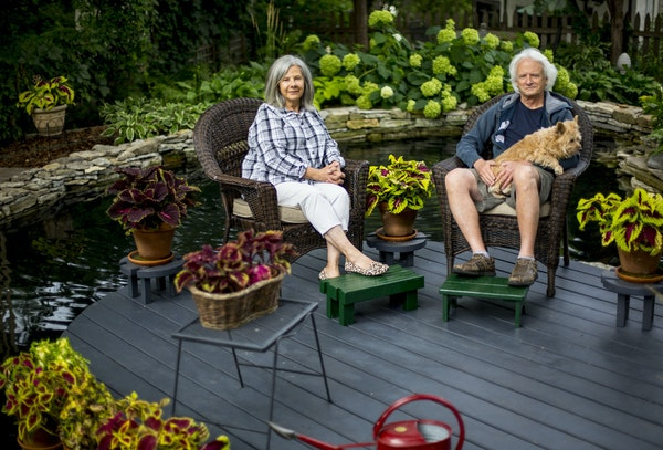 Top Christine Scotillo and Doug Peine, with their dog Gracie, view their backyard beds shaped by limestone walls. Above Concrete lambs accent the outd