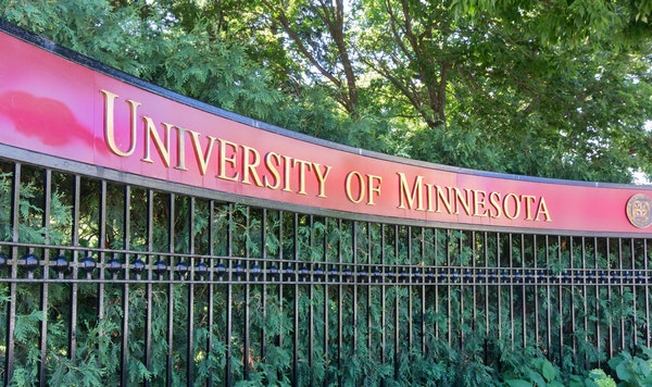 A former University of Minnesota student has won a $137,500 settlement of her lawsuit alleging that she was raped by an interpreter on a university-af