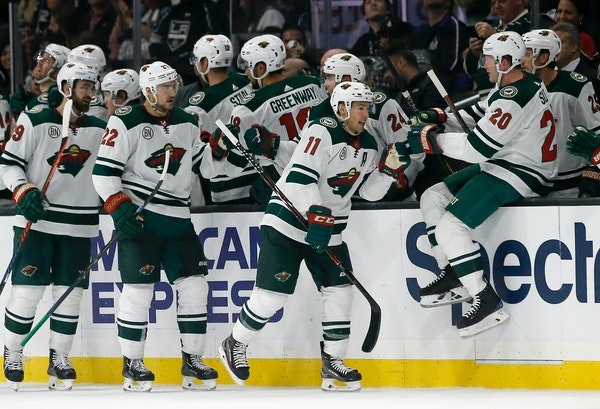 Wild left wing Zach Parise is congratulated by teammates after his goal during the second period against the Kings on Thursday.