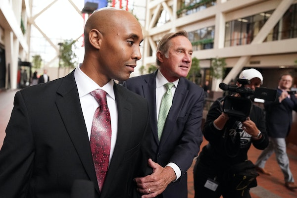Mohamed Noor, accompanied by his legal team, Peter Wold, and Tom Plunkett left following a probable cause hearing for the ex-Minneapolis cop Thursday,