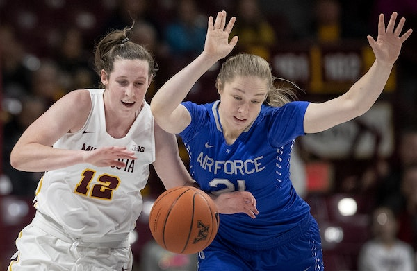 Gophers guard Mercedes Staples (12) was fouled by Michaela McFalls (21) of Air Force in the second quarter on Sunday.