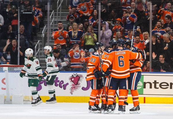 The Oilers celebrated a goal against the Wild during the third period Friday.