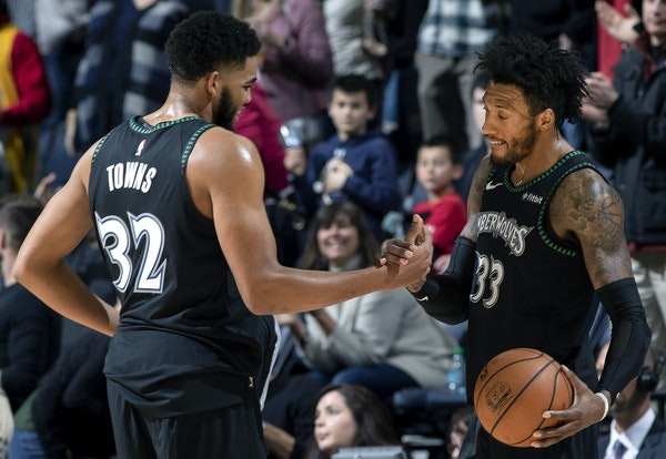 Karl-Anthony Towns and Jeff Teague celebrated at the end of the game. Minnesota beat Houston 103-91. ] CARLOS GONZALEZ ï cgonzalez@startribune.com ñ