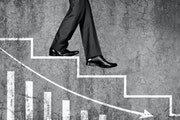 Low section view of a businessman moving down on stairs with graph chart representing the concept of Loss, Failure, Problems etc.