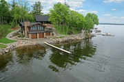 This double-duty boathouse/home combo on Gull Lake is on the market for $2.599 million.