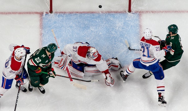 Wild winger Nino Niederreiter (22) stuffed the puck past Montreal goalie Antti Niemi for a goal in the first period of Minnesota's 7-1 shellacking of