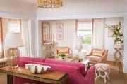 Living Coral color palette in a living room designed by Massucco Warner Miller.